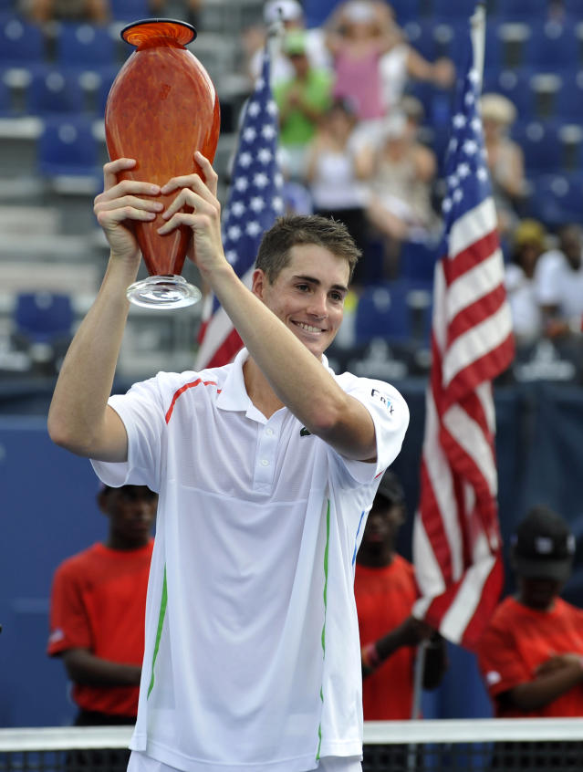 John Isner, of the United States, holds the winner's trophy after defeating Dudi Sela, of Israel, at the Atlanta Open tennis tournament Sunday, July 27, 2014, in Atlanta. Isner won 6-3, 6-4. (AP Photo/David Tulis)