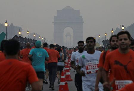 Participants run past India Gate as they take part in the Airtel Delhi Half Marathon in New Delhi, India, October 21, 2018. REUTERS/Anushree Fadnavis