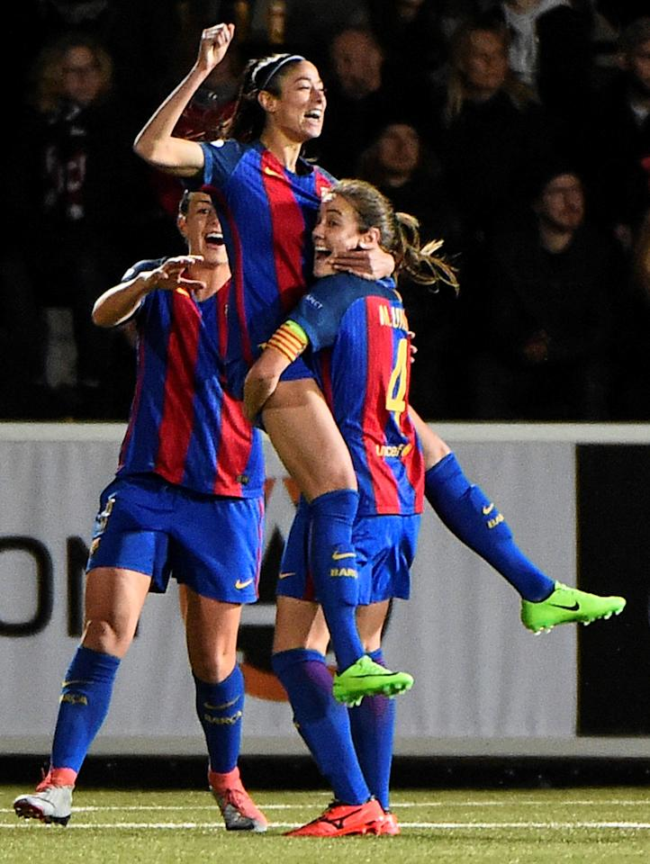 Football Soccer - FC Rosengard v FC Barcelona - UEFA Women's Champions League 1st Quarterfinal Match - Malmo IP Arena, Malmo, Sweden - 22/3/17 Barcelona's Leila Ouahabi (top) cheers with teammates after the 0-1 goal. TT NEWS AGENCY/Emil Langvad/via REUTERS ATTENTION EDITORS - THIS IMAGE WAS PROVIDED BY A THIRD PARTY. FOR EDITORIAL USE ONLY. SWEDEN OUT. NO COMMERCIAL OR EDITORIAL SALES IN SWEDEN