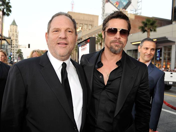 """Harvey Weinstein and Brad Pitt pose together at the premiere of """"Inglourious Basterds"""" in 2009."""