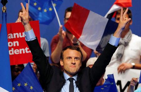 Emmanuel Macron, head of the political movement En Marche! (Onwards!) and candidate for the 2017 presidential election, waves to supporters at the end of a campaign rally in Pau, France, April 12, 2017. REUTERS/Regis Duvignau