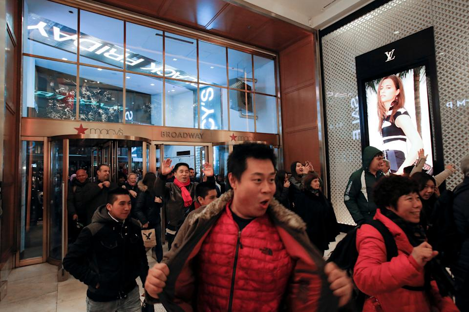 People enter Macy's Herald Square for an early opening of the Black Friday sales in Manhattan, New York, November 24, 2016. (REUTERS/Andrew Kelly)