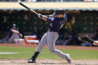 Seattle Mariners' Jarred Kelenic hits an RBI-single against the Oakland Athletics during the second inning of a baseball game in Oakland, Calif., Tuesday, Aug. 24, 2021. (AP Photo/Jeff Chiu)