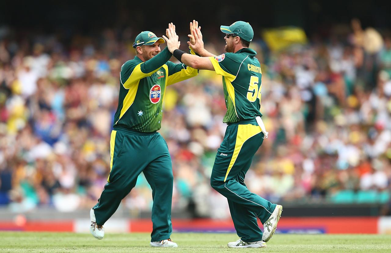 SYDNEY, AUSTRALIA - JANUARY 19: Aron Finch and Daniel Christian of Australia celebrate after Christian took a catch to dismiss Gary Balance of England during game three of the One Day International Series between Australia and England at Sydney Cricket Ground on January 19, 2014 in Sydney, Australia.  (Photo by Mark Nolan/Getty Images)