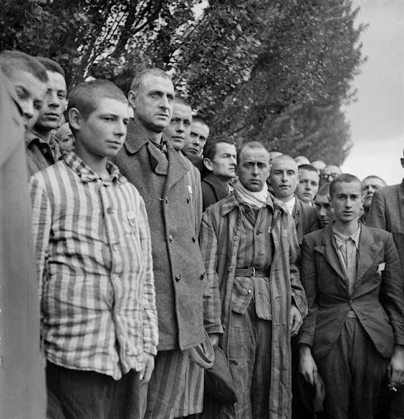 "French prisoners sing ""La Marseillaise"" after the Nazi concentration camp at Dachau in southern Germany was liberated by US soldiers on April 29, 1945 (AFP Photo/Eric Schwab)"
