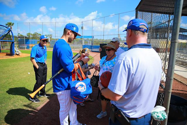 <p>New York Mets outfielder Tim Tebow signs for fans during spring training in Port St. Lucie, Fla., Feb. 23, 2018. (Photo: Gordon Donovan/Yahoo News) </p>