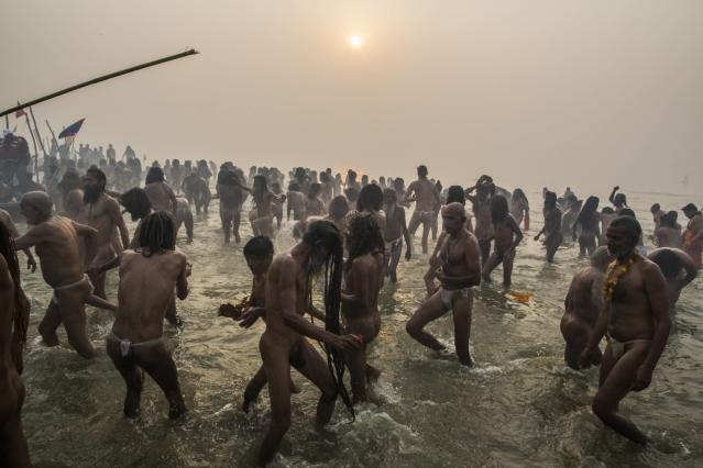 ALLAHABAD, INDIA - JANUARY 14: Naga sadhus bathe in the waters of the holy Ganges river during the auspicious bathing day of Makar Sankranti of the Maha Kumbh Mela on January 14, 2013 in Allahabad, India. The Maha Kumbh Mela, believed to be the largest religious gathering on earth is held every 12 years on the banks of Sangam, the confluence of the holy rivers Ganga, Yamuna and the mythical Saraswati. The Kumbh Mela alternates between the cities of Nasik, Allahabad, Ujjain and Haridwar every three years. The Maha Kumbh Mela celebrated at the holy site of Sangam in Allahabad, is the largest and holiest, celebrated over 55 days, it is expected to attract over 100 million people. (Photo by Daniel Berehulak/Getty Images)