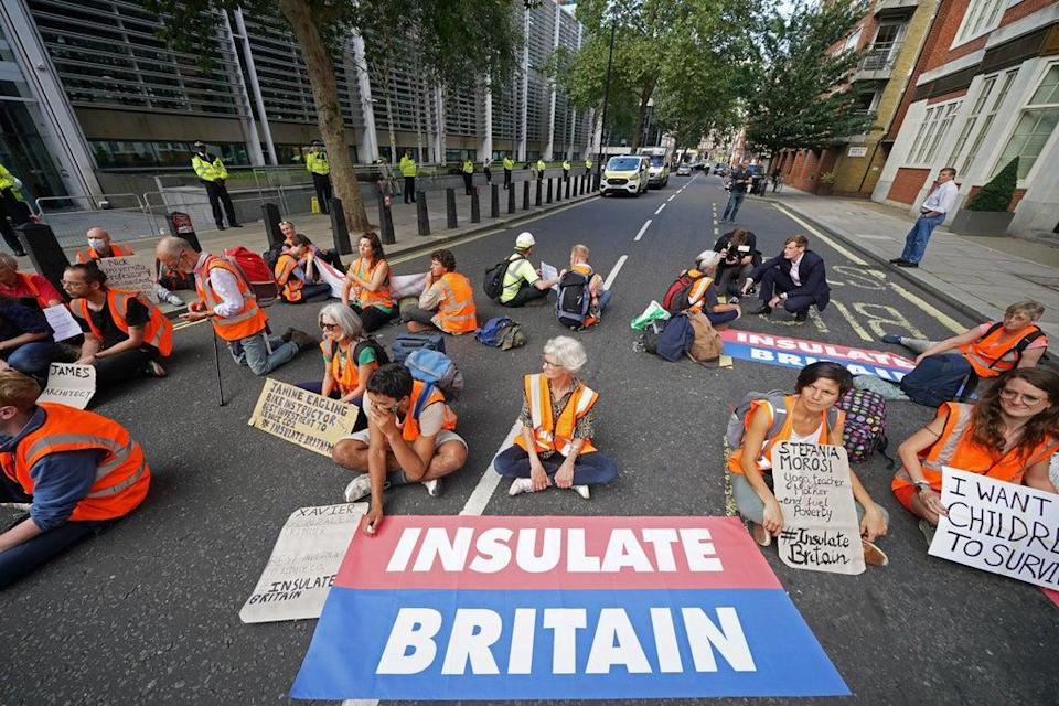 Protesters block a road outside the Home Office (PA) (PA Wire)