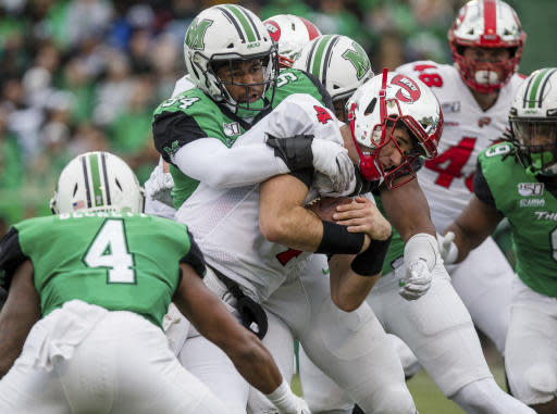 Marshall's Channing Hames (94) brings down Western Kentucky quarterback Ty Storey (4) during an NCAA college football game Saturday, Oct. 26, 2019, in Huntington, W.Va. (Sholten Singer/The Herald-Dispatch via AP)
