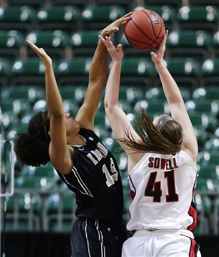 Idaho's Ali Forde (13) blocks a shot by Seattle's Kacie Sowell (41) in the first half of their NCAA college basketball game in the Western Athletic Conference tournament championship, Saturday, March 16, 2013, in Las Vegas. (AP Photo/Julie Jacobson)