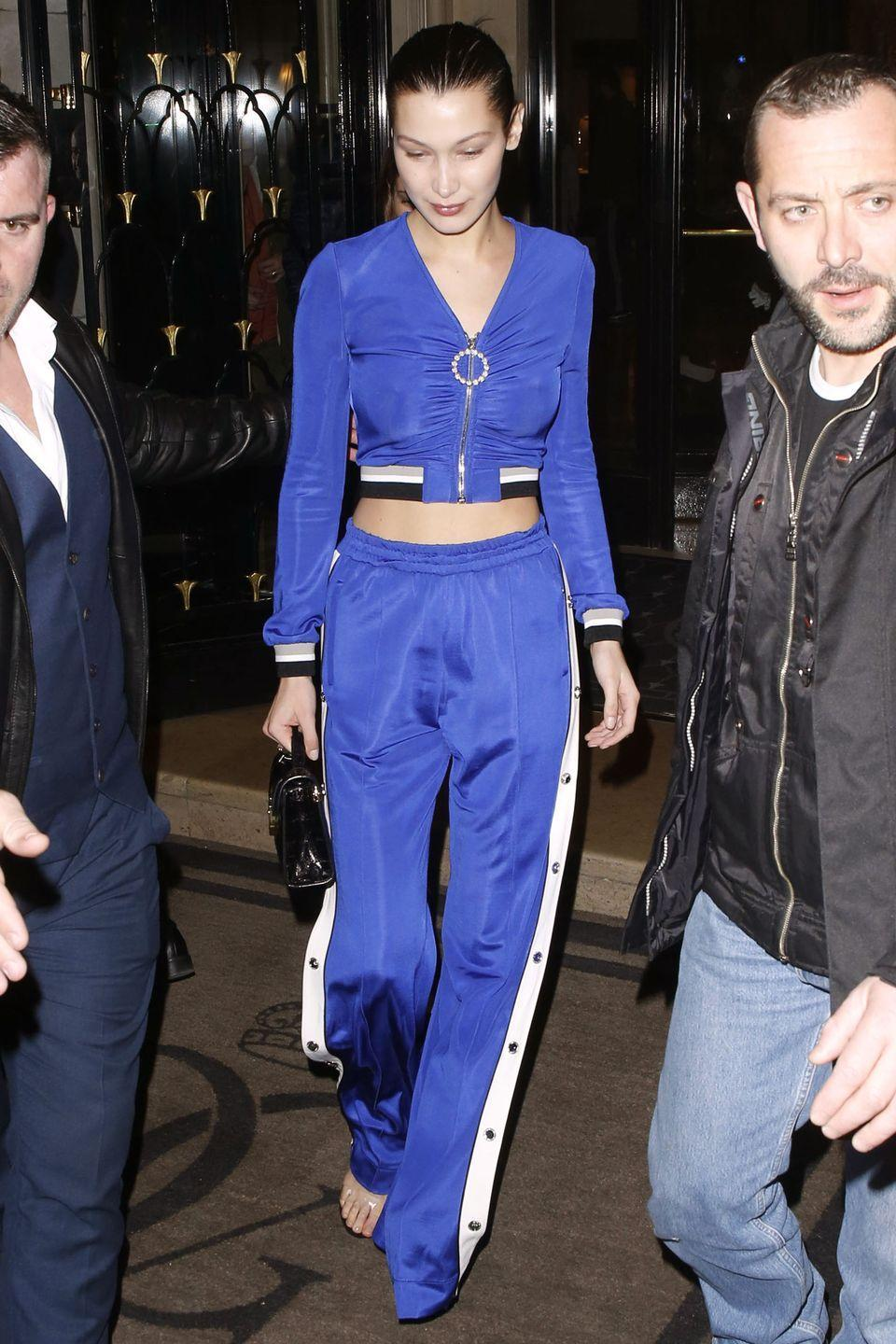 <p>In a Alessandra Rich cobalt blue tracksuit with a Dior bag while out in Paris.</p>