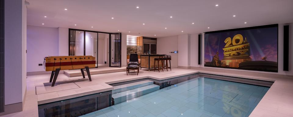 The leisure room which has a pool doubles as a cinema room. Photo: Getty Images