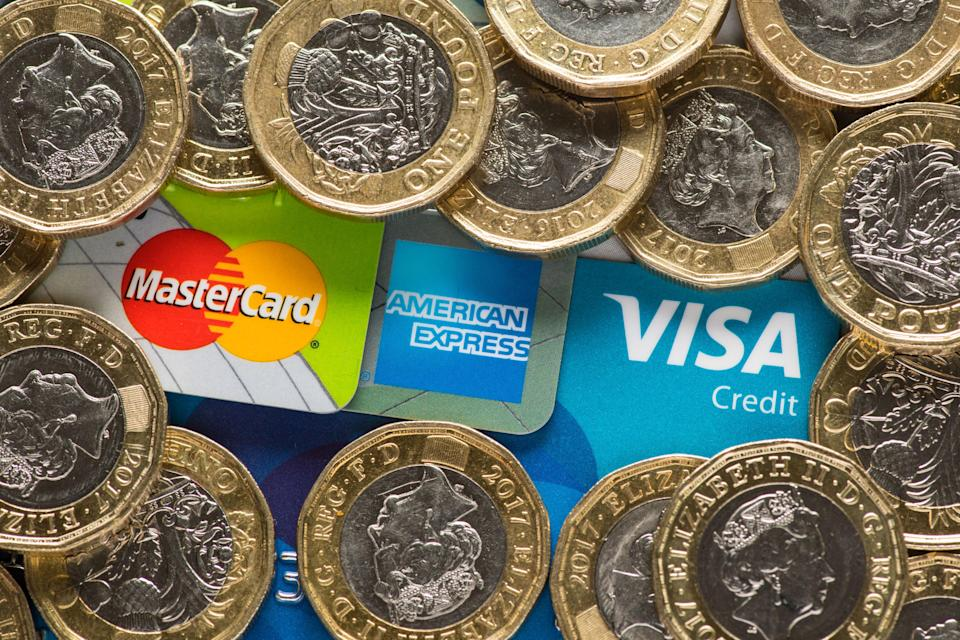 Mastercard, American Express and Visa credit cards with UK one pound coins. Photo: Dominic Lipinski/PA Images for Getty Images