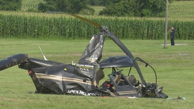 A Robinson R44 helicopter, operated by Apex Helicopters, was doing aerial spray work north to northeast of the Brantford Airport when it clipped a power line and crashed, according to the Transportation Safety Board of Canada (David Ritchie/CBC - image credit)
