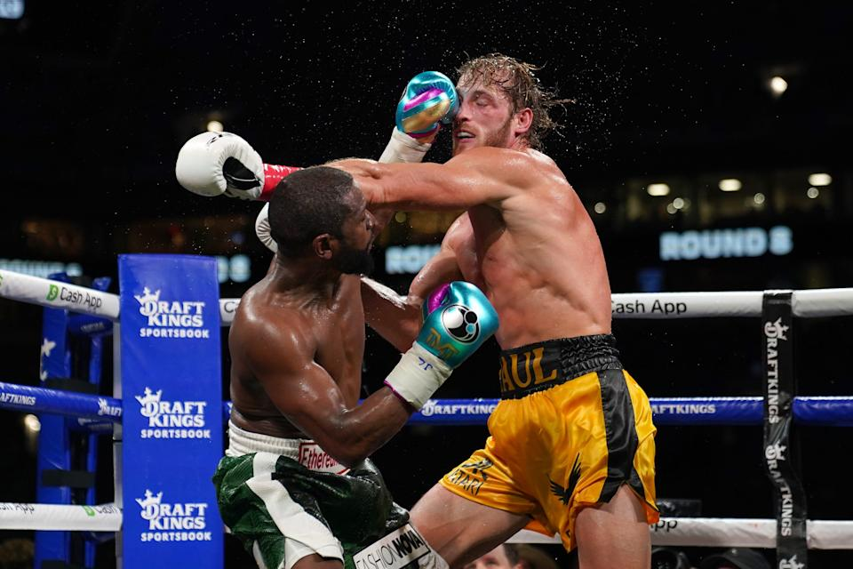 Floyd Mayweather Jr. fights Logan Paul during an exhibition boxing match at Hard Rock Stadium.