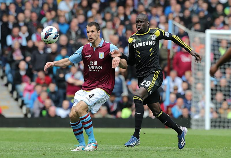 Chelsea's Demba Ba, right, and Aston Villa's Ron Vlaar battle for the ball during the English Premier League soccer match at Villa Park, Birmingham, England, Saturday May 11, 2013. Chelsea won the match 1-2. (AP Photo/PA, Nick Potts) UNITED KINGDOM OUT NO SALES NO ARCHIVE