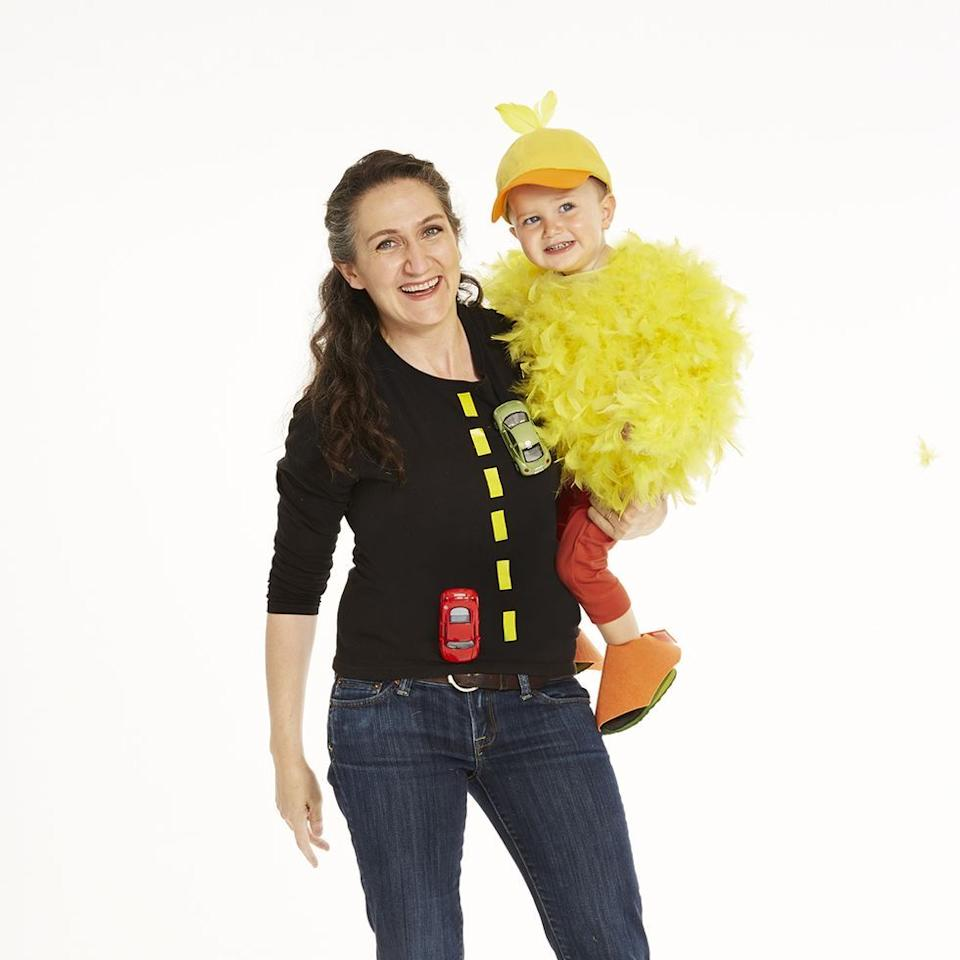 """<p>Why did the chicken cross the road? To get to his mommy, of course! Take this popular joke and turn it into a costume with a couple of yellow feathers and toy cars.</p><p><em><a href=""""https://www.womansday.com/style/fashion/a28680113/chicken-and-road-costume/"""" target=""""_blank"""">Get the tutorial for Chicken and Road</a>. </em></p><p><strong>What You'll Need</strong>: <a href=""""https://www.amazon.com/Sivvan-Womens-Comfort-T-Shirt-Underscrub/dp/B01KY7HBDW/ref=sr_1_4?keywords=black+long+sleeved+shirt+women&qid=1568212136&s=gateway&sr=8-4"""" target=""""_blank"""">Black long-sleeved shirt</a> ($5, Amazon); <a href=""""https://www.amazon.com/Yeonha-Toys-Vehicles-Assorted-Construction/dp/B01MUC9GPU/ref=sr_1_5?keywords=toy+cars&qid=1568212101&s=gateway&sr=8-5"""" target=""""_blank"""">toy cars</a> ($9, Amazon); <a href=""""https://www.amazon.com/Cynthias-Feathers-Chandelle-Feather-Patterns/dp/B01DOEU9ZY/ref=sr_1_6?keywords=yellow+feather+boas&qid=1568212070&s=gateway&sr=8-6"""" target=""""_blank"""">yellow feather boas</a> ($9, Amazon)</p>"""