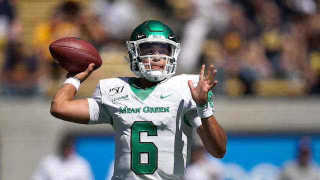 "Clearly stuck in the Halloween spirit, North Texas quarterback <a class=""link rapid-noclick-resp"" href=""/ncaaf/players/268411/"" data-ylk=""slk:Mason Fine"">Mason Fine</a> wore an inflatable T-Rex costume after throwing seven touchdowns Saturday afternoon. (AP/Tony Avelar)"