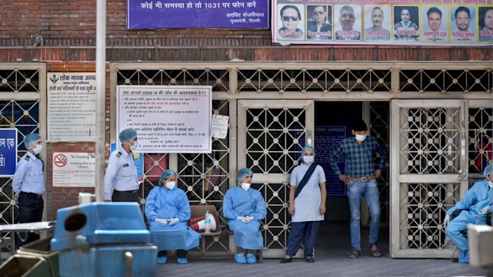 Doctors and other medical staff seen in PPE outside emergency ward on day nineteen of the 21-day nationwide lockdown to check the spread of coronavirus, outside Lok Nayak Jai Prakash Narayan (LNJP) Hospital, on April 12, 2020 in New Delhi, India.