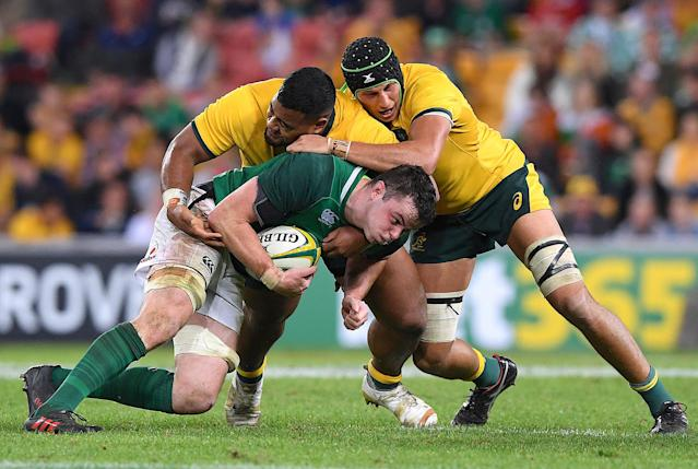 Rugby Union - June Internationals - Australia vs Ireland - Lang Park, Brisbane, Australia - June 9, 2018 - James Ryan of Ireland is tackled by Taniela Tupou and Adam Coleman of Australia. AAP/Dave Hunt/via REUTERS ATTENTION EDITORS - THIS IMAGE WAS PROVIDED BY A THIRD PARTY. NO RESALES. NO ARCHIVE. AUSTRALIA OUT. NEW ZEALAND OUT.