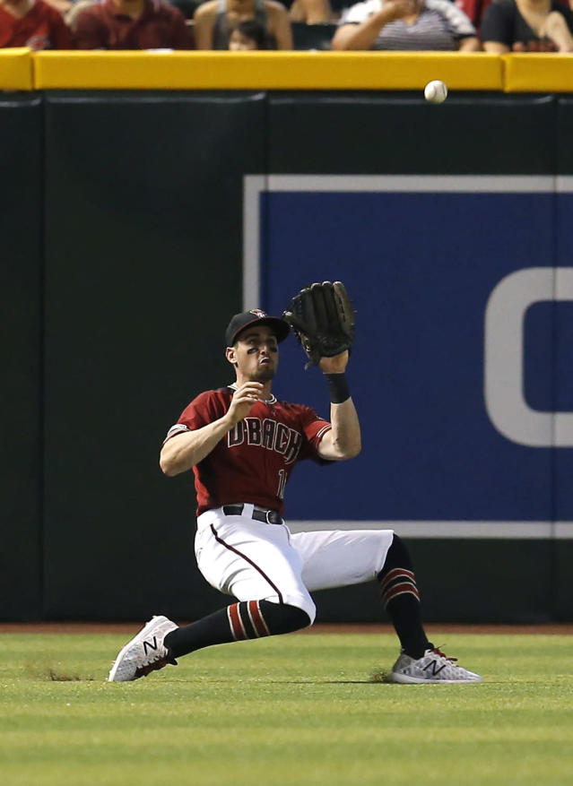 Arizona Diamondbacks left fielder Tim Locastro makes the running catch for an out on a ball hit by Washington Nationals' Patrick Corbin in the fifth inning of a baseball game, Sunday, Aug. 4, 2019, in Phoenix. (AP Photo/Rick Scuteri)