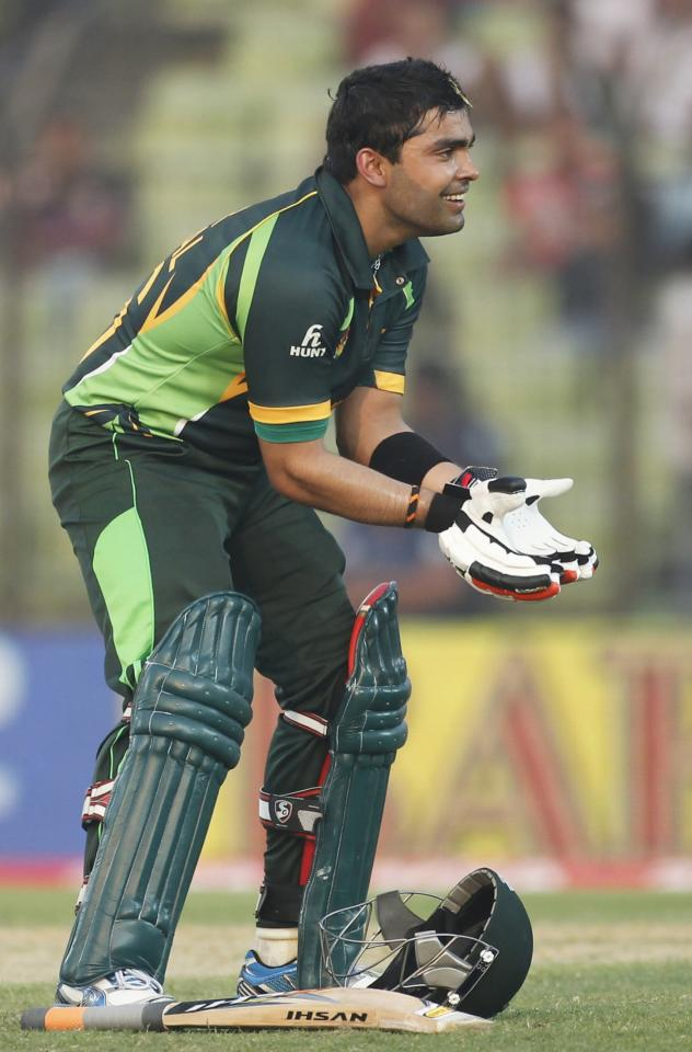 Pakistan's Umar Akmal celebrates after scoring half century against Afghanistan during their Asia Cup 2014 one-day international (ODI) cricket match in Fatullah February 27, 2014. REUTERS/Andrew Biraj (BANGLADESH - Tags: SPORT CRICKET)