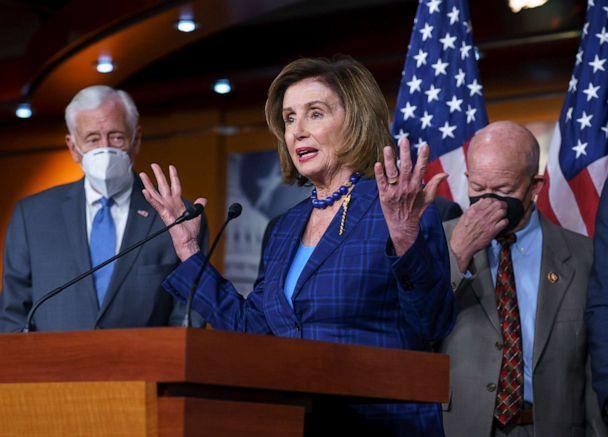 PHOTO: Speaker of the House Nancy Pelosi, D-Calif., flanked by Majority Leader Steny Hoyer, D-Md., left, discusses her legislative agenda, including voting rights, public health, and infrastructure, during a news conference at the Capitol, July 30, 2021. (J. Scott Applewhite/AP)