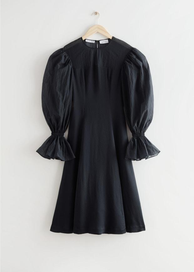 """<p>& Other Stories x Rejina Pyo Organza Sleeve Silk Midi Dress, $249, <a href=""""https://rstyle.me/+mbC7lCeocw_g6HBysD8J8Q"""" rel=""""nofollow noopener"""" target=""""_blank"""" data-ylk=""""slk:available here"""" class=""""link rapid-noclick-resp"""">available here</a> (sizes US 0-12). </p>"""