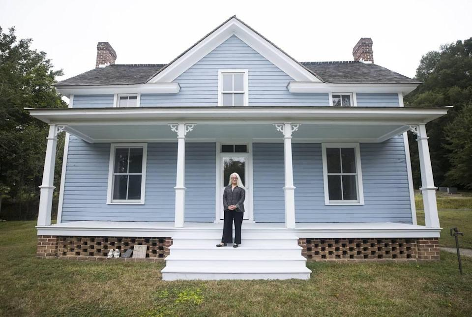 Barbara Lau, executive director of the Pauli Murray Center for History and Social Justice, poses for a portrait on the front steps of Murray's childhood home in Durham, N.C. on Tuesday, Sept. 21, 2021. Lau is The News & Observer's September 2021 Tar Heel of the Month.