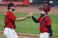 Cleveland Indians relief pitcher Brad Hand and catcher Roberto Perez celebrate a victory over the Chicago White Sox in a baseball game, Monday, Sept. 21, 2020, in Cleveland. (AP Photo/Ron Schwane)