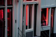 The red lights are back on in Amsterdam after Dutch brothels were allowed to reopen on July 1, 2020 (AFP Photo/Kenzo TRIBOUILLARD)