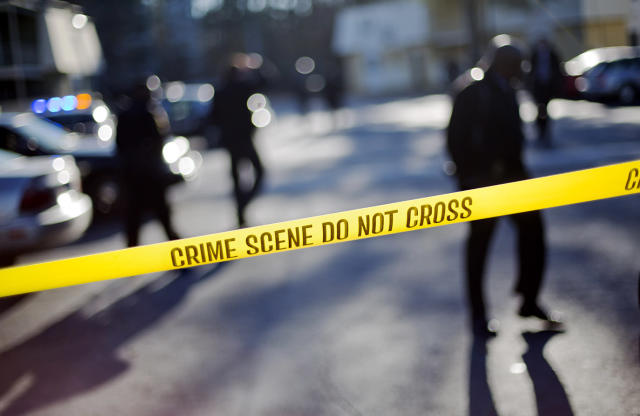 <p>Crime scene tape blocks of the area of an apartment complex where authorities say two police officers were shot, leading to a neighborhood search for the suspected gunman, Dec. 12, 2014, in Decatur, Ga. (AP Photo/David Goldman) </p>