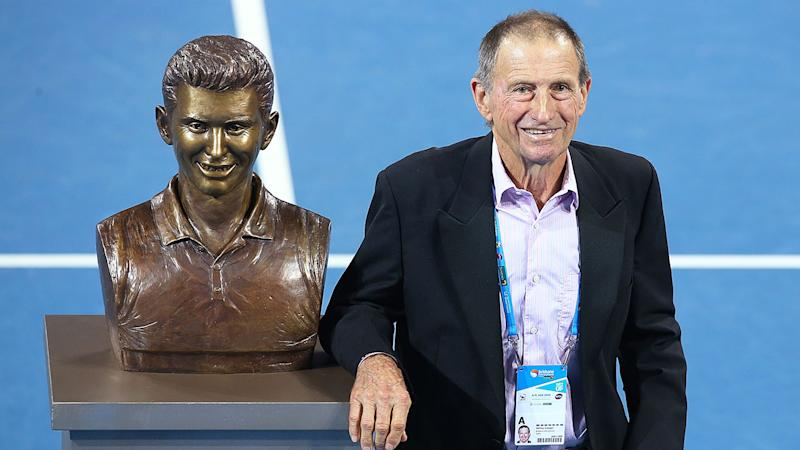 Seen here, Aussie tennis great Ashley Cooper standing next to his statue.