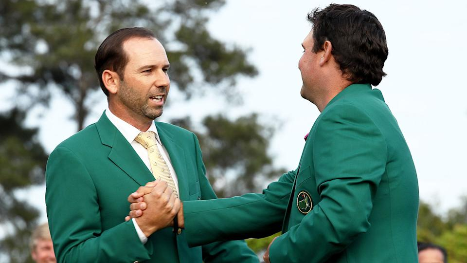 Pictured here, 2017 Masters champ Sergio Garcia presents 2018 winner Patrick Reed with his green jacket.