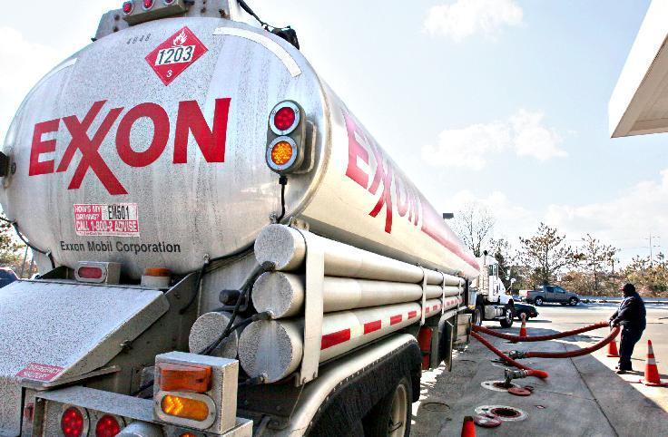 FILE - In this Jan. 30, 2009 file photo, an Exxon tanker truck makes a refueling stop at an Exxon station in Arlington, Va. Exxon Mobil Corp. was found liable Tuesday, April 9, 2013, in a long-running lawsuit over groundwater contamination caused by the gasoline additive MTBE, and the jury ordered the oil giant to pay $236 million to New Hampshire to clean it up.  (AP Photo/J. Scott Applewhite, File)