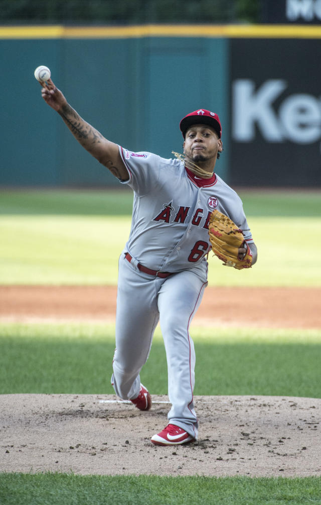 Los Angeles Angels starting pitcher Felix Pena delivers to Cleveland Indians' Francisco Lindor during the first inning of a baseball game in Cleveland, Saturday, Aug. 3, 2019. (AP Photo/Phil Long)