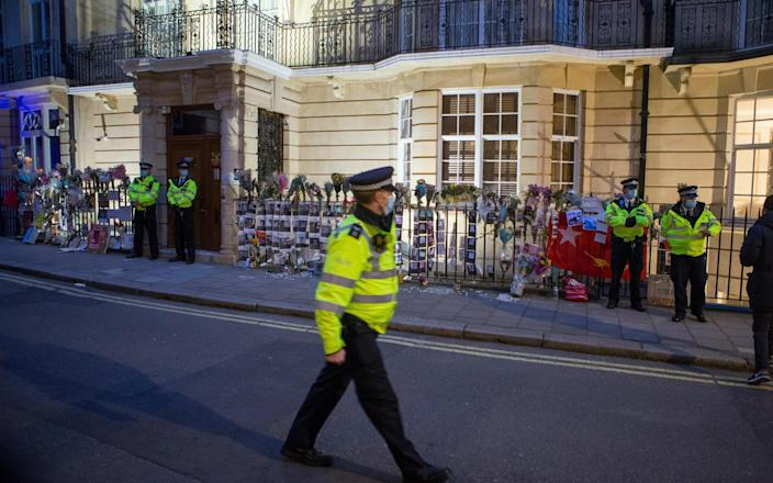 Police stand outside Embassy of the Republic of the Union of Myanmar in London - Jamie Lorriman
