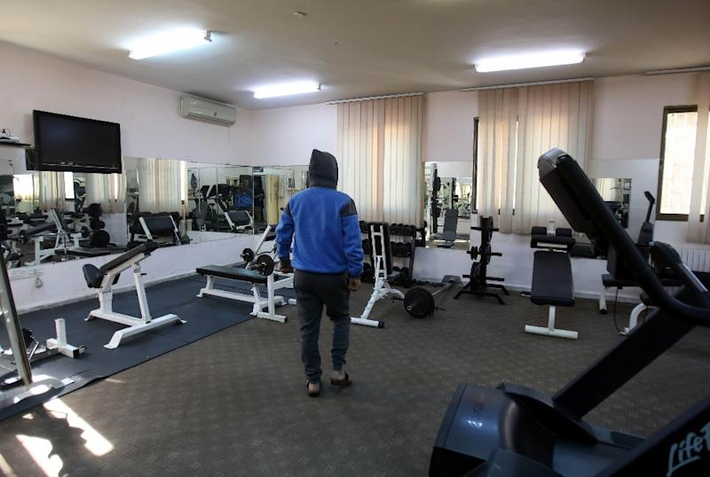 A drug-dependent youth in the gym of a government-run rehabilitation centre in Amman (AFP Photo/Khalil MAZRAAWI)