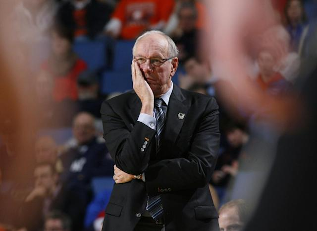 "FILE - In this March 20, 2014, file photo, Syracuse head coach Jim Boeheim watches his team play during the second half of a second-round game in the NCAA college basketball tournament in Buffalo, N.Y. Syracuse university officials say coach Boeheim will retire in three years and athletic director Daryl Gross has resigned following punishment from the NCAA for violations that lasted more than a decade. Chancellor Kent Syverud said Wednesday, March 18, 2015, that Boeheim, a Hall of Famer and head coach for 39 years, decided to make the announcement to ""bring certainty to the team and program in the coming years"" and to allow for a smooth transition. (AP Photo/Bill Wippert, File)"