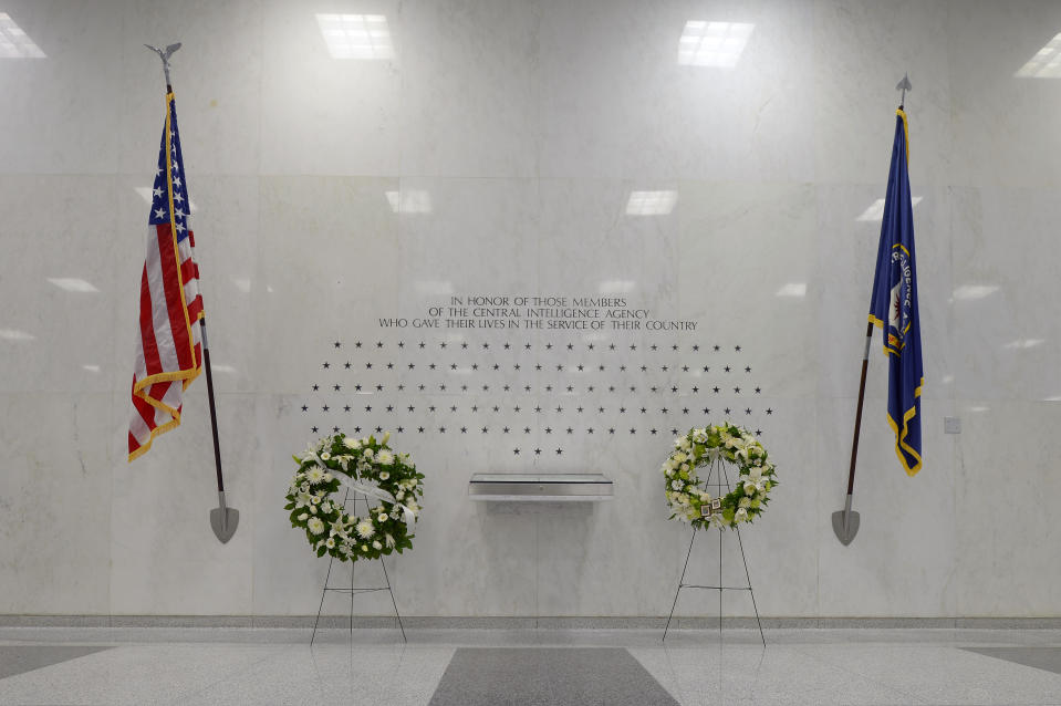 CIA Memorial Wall in the lobby of the CIA headquarters with stars signifying the agents and contractors killed in the line of duty