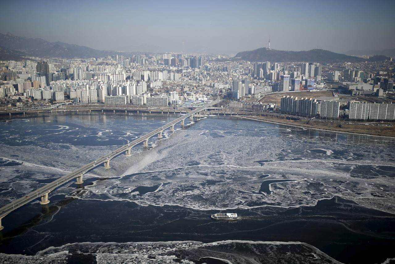 A passenger ship navigates through the ice flow in the Han River in Seoul