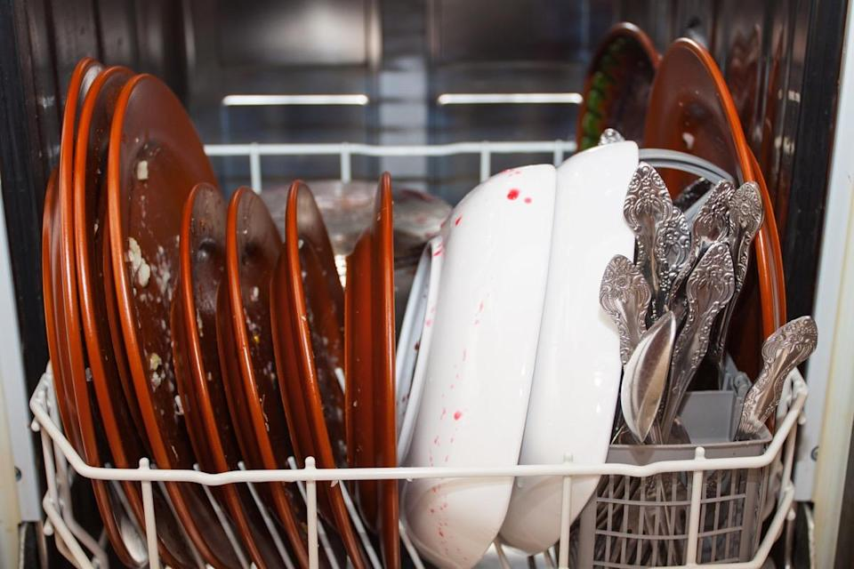 """Your dishwasher cleans your dishes, but don't expect it to get the job done in the same way when it comes to cleaning itself. """"One of the main issues with dishwashers is that over time, food residue, grease, and soap scum can build up, [and] this keeps your dishwasher from working properly,"""" explains <strong>Cate Griffing</strong>, co-owner of <a href=""""https://www.wow1day.com/"""" rel=""""nofollow noopener"""" target=""""_blank"""" data-ylk=""""slk:Wow 1 Day Painting"""" class=""""link rapid-noclick-resp"""">Wow 1 Day Painting</a>, Griffing Kitchens & Interiors, and <a href=""""https://westmagnoliacharm.com/"""" rel=""""nofollow noopener"""" target=""""_blank"""" data-ylk=""""slk:West Magnolia Charm"""" class=""""link rapid-noclick-resp"""">West Magnolia Charm</a>. To avoid any issues, Griffing says you should clean <a href=""""https://bestlifeonline.com/dishwasher-mistakes/?utm_source=yahoo-news&utm_medium=feed&utm_campaign=yahoo-feed"""" rel=""""nofollow noopener"""" target=""""_blank"""" data-ylk=""""slk:your dishwasher"""" class=""""link rapid-noclick-resp"""">your dishwasher</a> every three months."""