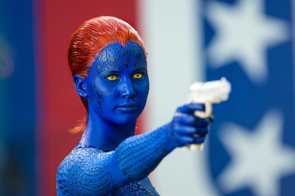 Jennifer Lawrence as Mystique pointing a gun in an image from 2014 X-Men: Days of Future Past (20th Century Fox)