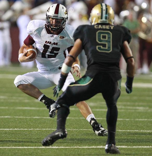 Louisiana-Monroe quarterback Kolton Browning, left, sidesteps Baylor's Chance Casey during the first half of an NCAA college football game, Friday, Sept. 21, 2012, in Monroe, La. (AP Photo/Waco Tribune Herald, Duane A. Laverty)