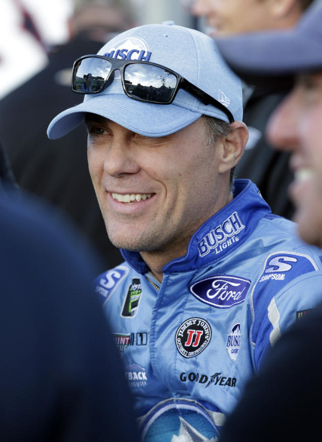 NASCAR Cup Series driver Kevin Harvick waits between sessions during qualifying for this weekend's auto race at Kansas Speedway in Kansas City, Kan., Friday, Oct. 19, 2018. (AP Photo/Colin E. Braley)