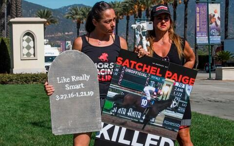 <span>Campaigners protest about the high number of fatalities at Santa Anita</span> <span>Credit: MARK RALSTON/AFP </span>