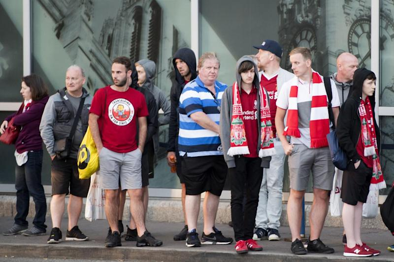 Liverpool fans making their way back home from John Lennon Airport after the UEFA Champions League Final (PA)