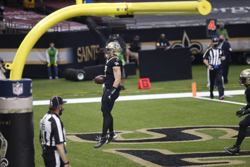 New Orleans Saints quarterback Taysom Hill (7) leaps in the air after scoring on a touchdown carry in the second half of an NFL football game against the Atlanta Falcons in New Orleans, Sunday, Nov. 22, 2020. (AP Photo/Brett Duke)