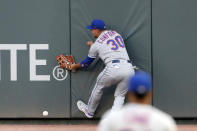 New York Mets right fielder Michael Conforto can't get to a ball hits for an RBI double by Atlanta Braves' Tyler Flowers during the second inning of a baseball game Saturday, Aug. 1, 2020, in Atlanta. (AP Photo/John Bazemore)