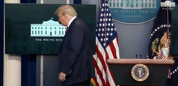 President Trump is escorted from the White House press briefing room Monday, shortly after starting a news conference. (Photo: HuffPost)
